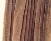 50s or 60s era brown and khaki or gold pleated skirt. Pretty and in great shape. Size S/M
