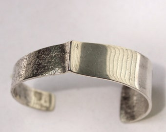 Mid Century Modernist sterling cuff bracelet with texture signed LAC