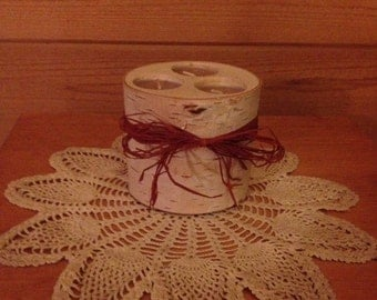 White birch three tealight candle holder decorated with brown raffia