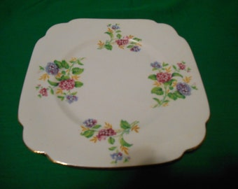 "One (1), Bone China, 8"" Luncheon / Salad Plate, from Clarence China, in a Unknown Pattern of Flowers."
