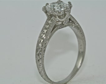 14kt White Gold and Diamond Art Deco Design Hand Engraved Engagement Ring with 1.35ct Moissanite Center