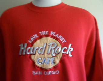 vintage 90's Hard Rock Cafe San Diego California red fleece embroidered applique logo tourist souvenir graphic sweatshirt crew neck pullover