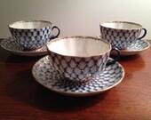 Tea cup/saucer set, flow blue cobalt net pattern, Lomonosov, Russia