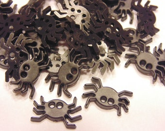 7 small flat spider buttons, 16 x 11 mm (9)
