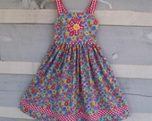 Size 6 cotton handmade sundress for girls with multicolored all over flowers and red gingham checked piping straps and lower band