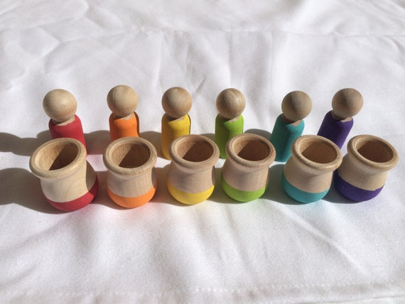 Montessori inspired matching game with peg dolls and cups