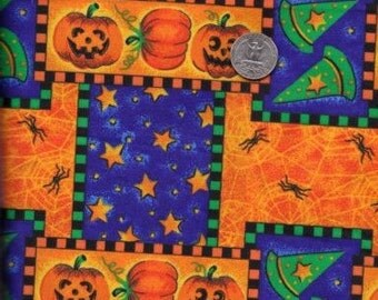Pumpkins, spiders, and witches hats Halloween fabric