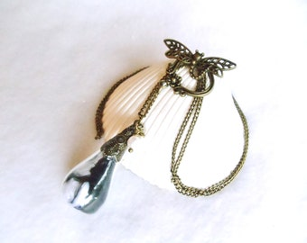 Glass teardrop necklace on antique bronze chain with dragonfly clasp