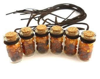 Natural Baltic Amber on miniature glass bottles -4 bottles avalible