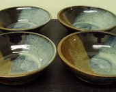 4 bowl set in Black, blue and red glaze....