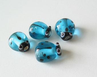 Glass ladybug beads turquoise blue 4 pcs.