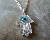 Evil eye heart hamsa pendant.