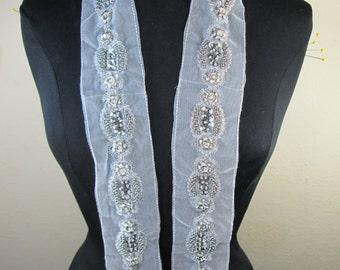 Very beautiful silver beads with silver thread lace trim.