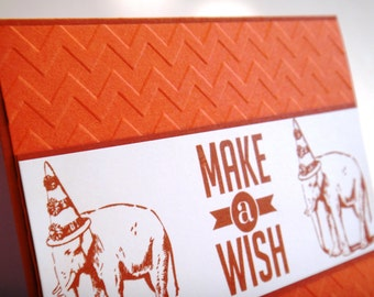 Elephant birthday card make a wish quirky bright orange hand made birthday card for dad brother husband friend wearing party hat chevron