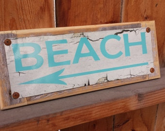 Recycled wood framed street sign beach arrow