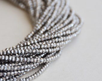 gun metal opaque faceted glass rondell Beads (1 strand)