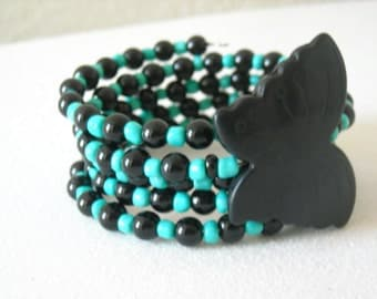 Black Magnesite Stone Butterfly, with Black and Turquoise Beaded Memory Wire Bracelet