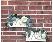 Mr. & Mrs. Wooden Rustic Wedding Sweetheart Table or Chair Signs With Eucalyptus Leaves and White Flowers Painted White With Gold Lettering