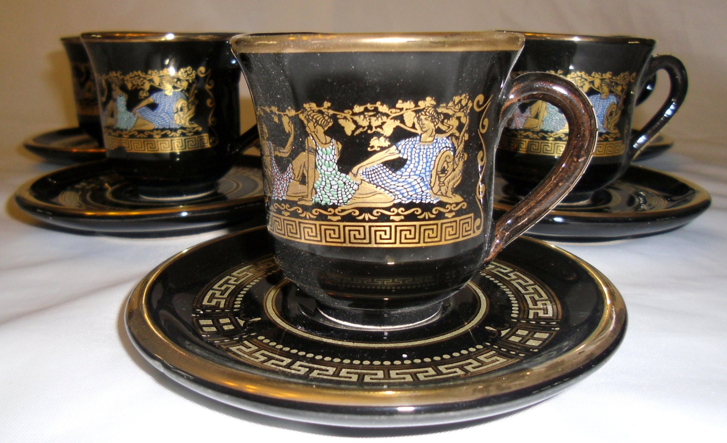 hand made greek 24k gold accent black tea cup saucer set. Black Bedroom Furniture Sets. Home Design Ideas
