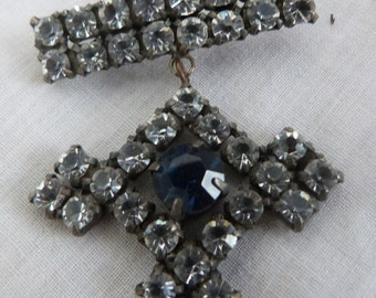 A lovely hanging jeweled cross brooch