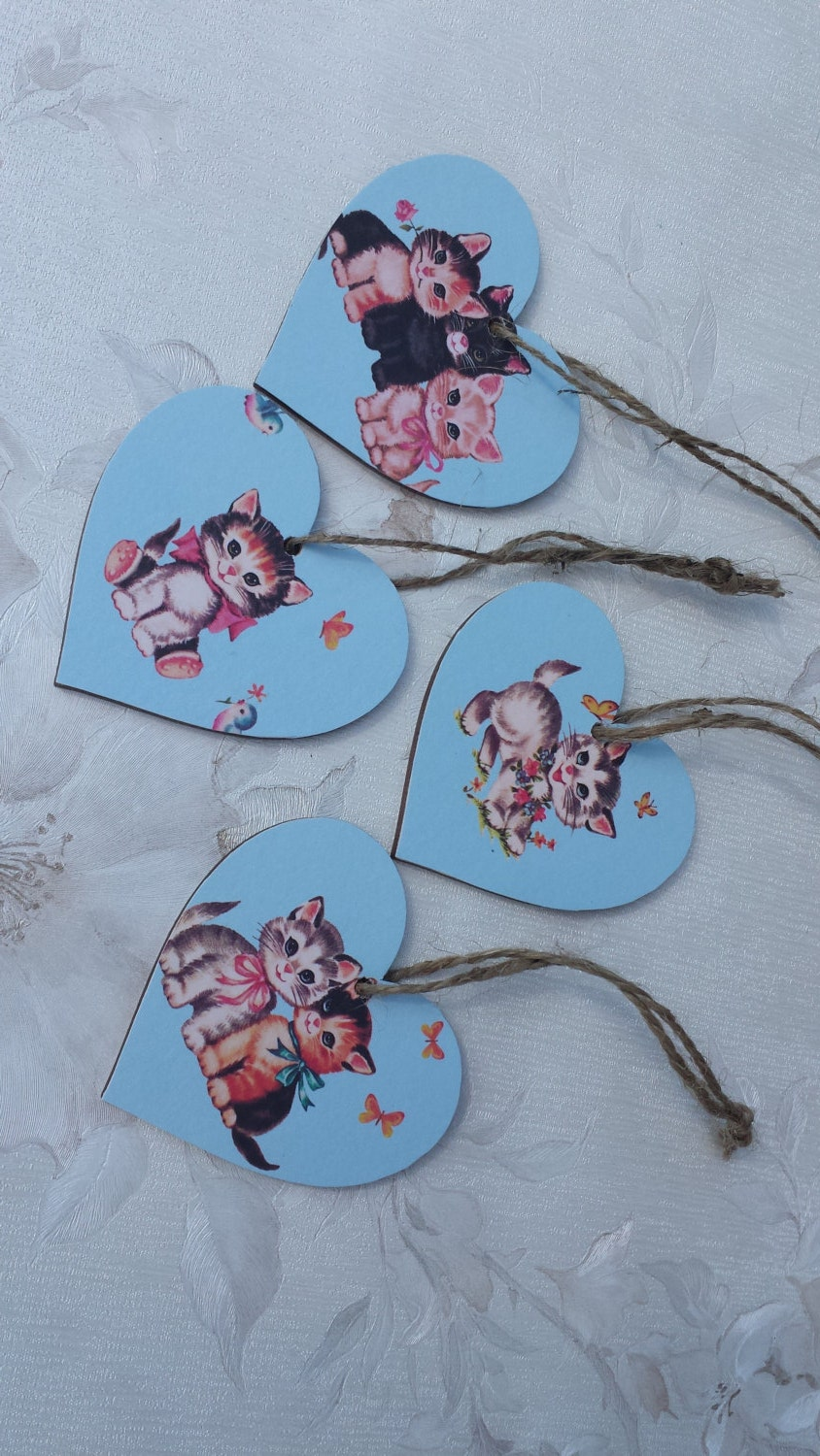 Cute little kittens on a trio of wooden hearts