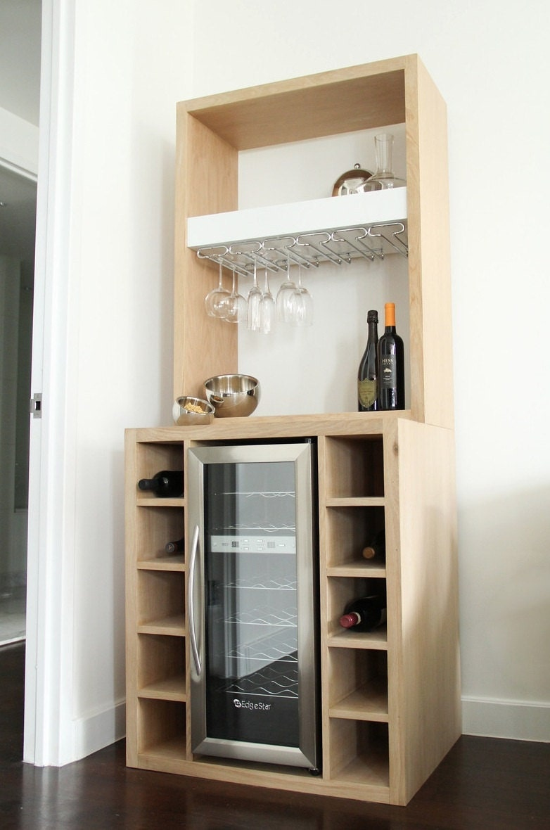 White oak bar with built in wine cooler and glass rack Built in bar cabinets