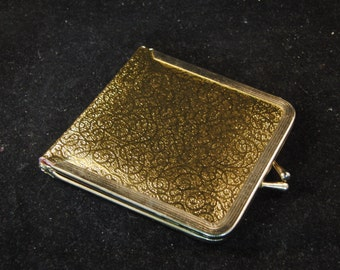 Vintage golden colored mirror purse