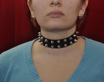 "Handmade black leather collar, decorated with short sharp metal spikes, about 1.2"" (30 mm) wide"