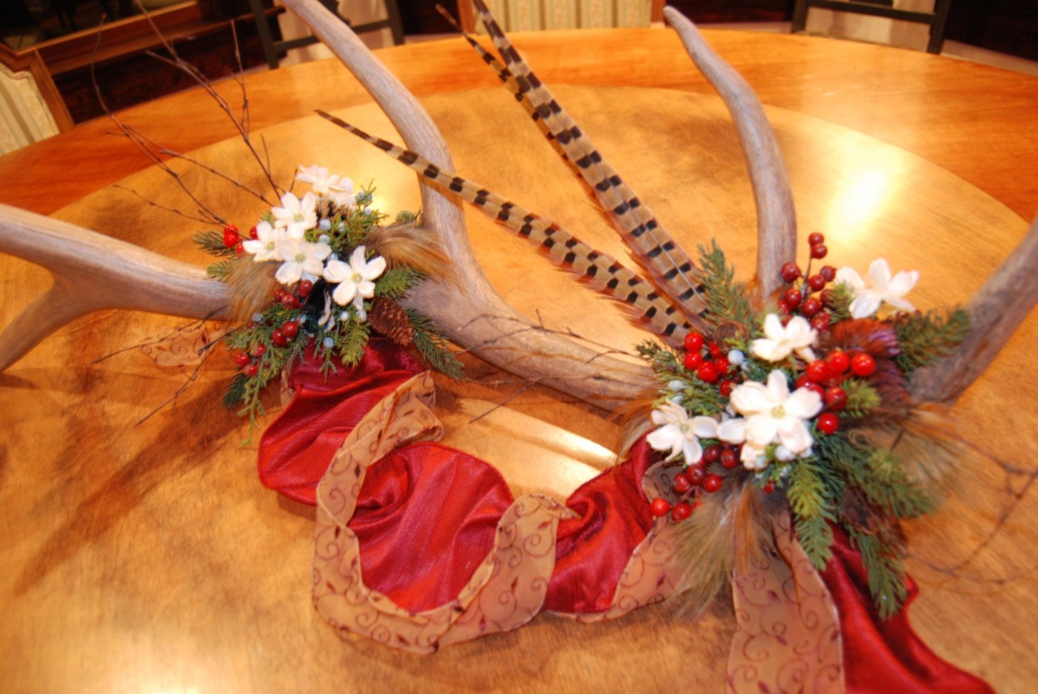 Elk antler and pheasant feather floral centerpiece