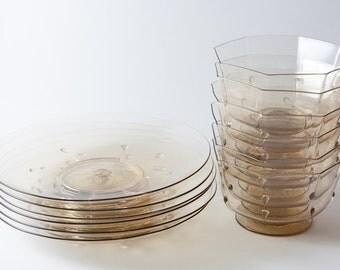 Bowls and plates set. Art Nouveau glass.