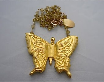 Butterfly necklace in 18K plated gold on yellow citrine chain. Statement jewelry on trend, nature inspiration. Chic & fun.