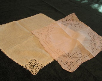 vintage hankies, one white with crochet, one pink with drawn work