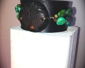 LEATHER CUFF adorned with Turquoise and black handmade ceramic centerpiece