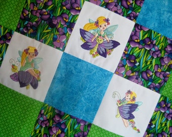 MADE TO ORDER Embroidered baby quilt - Fairy Flight - patchwork with butterflies and fairies in purple, aqua and lime green with minky back
