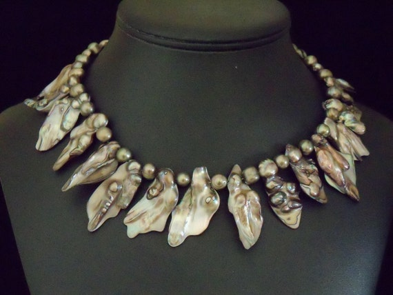 Baroque and freshwater pearl necklace with sterling extender and hook.