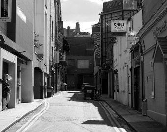 "Irish street photography ""Smoke Break"", European street scene, Ireland, Dublin, woman smoking, cigarette, urban, alley, black and white"