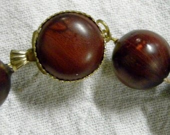 Vintage 1950s wooden bead necklace with unique closure clasp and deep earthtones
