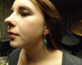 Malachite earrings set in sterling silver...