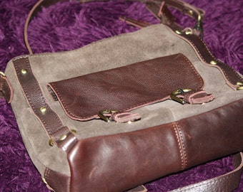 handbag with long shoulder strap