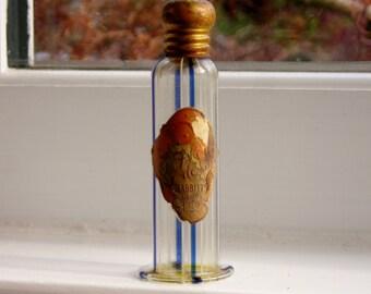 Fleur de Nuit perfume bottle by Babbitt in Philadelphia, Pennsylvania. Blown glass, striped blue and white. 1920s.