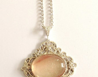 Unique Sterling Silver pendant with large Rose Quartz gem and long Sterling Silver Necklace