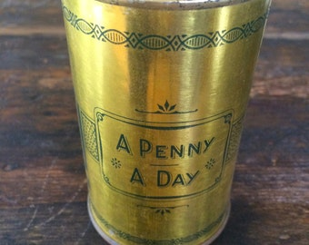 Vintage Coin Bank / A Penny A Day / Federation Foundation Fund Gold Colored Can Bank / Piggy Bank