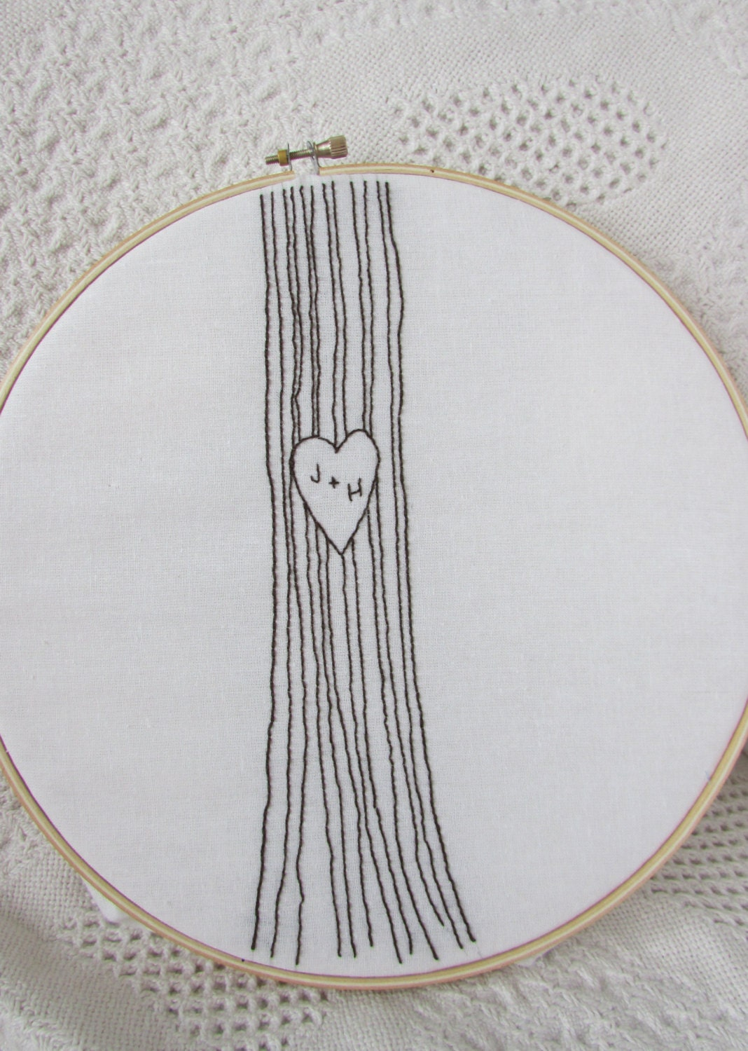 Hand embroidery pattern initials in a tree