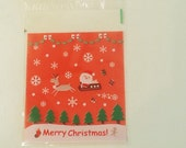 Red Santa Clause cello bags with self-adhesive seal