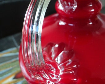 Bright red coloured glass vase