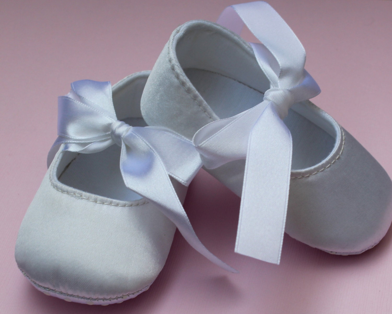 white satin ballet baby shoes