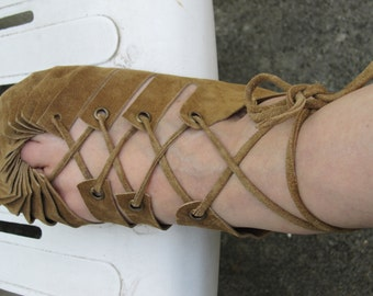 Brown  lace-up moccasins, sandals