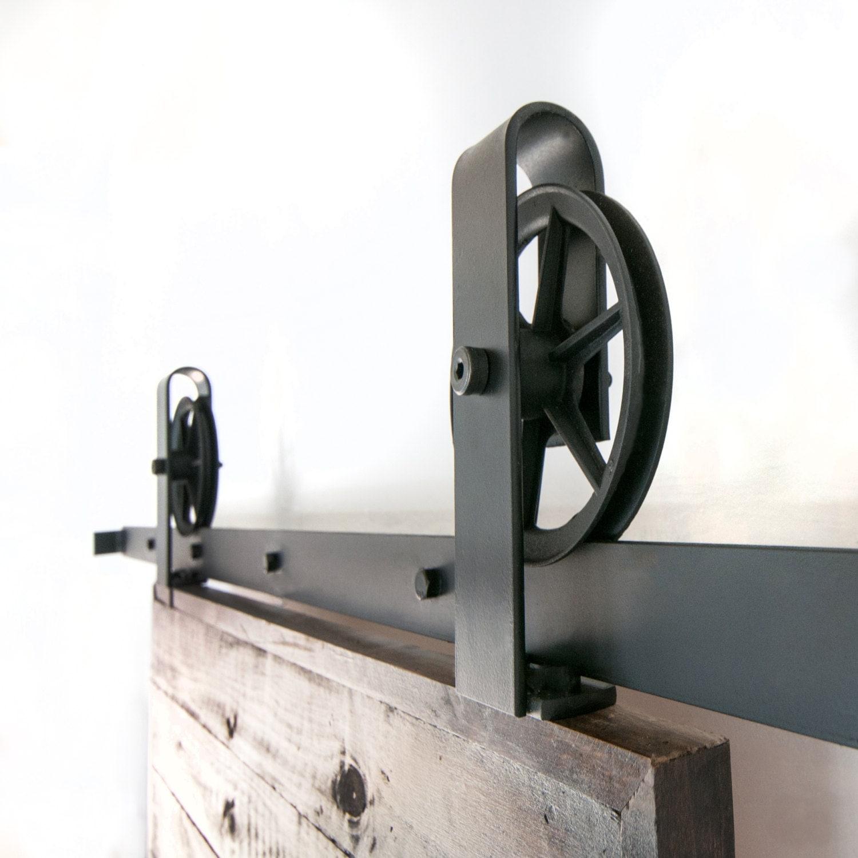 Vintage industrial spoked european top mount sliding barn door for Top mount barn door hardware