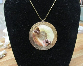 "Onyx on Brass (2-1/4"") Pendant with 30"" Gold Filled chain."