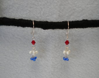 Red, white and blue dangle earrings.